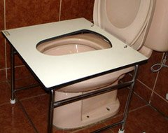 toilet squatting platform in use with sitting toilet